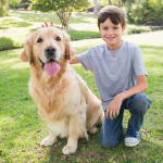Boy and his dog on lawn
